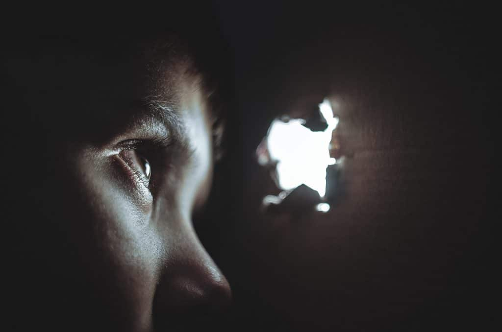 Boy hiding dark