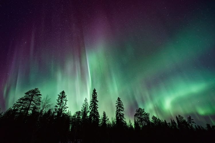 silhouette against the northern lights, northern lights facts