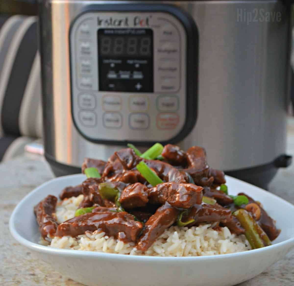 Mongolian Beef with rice and green vegetables.