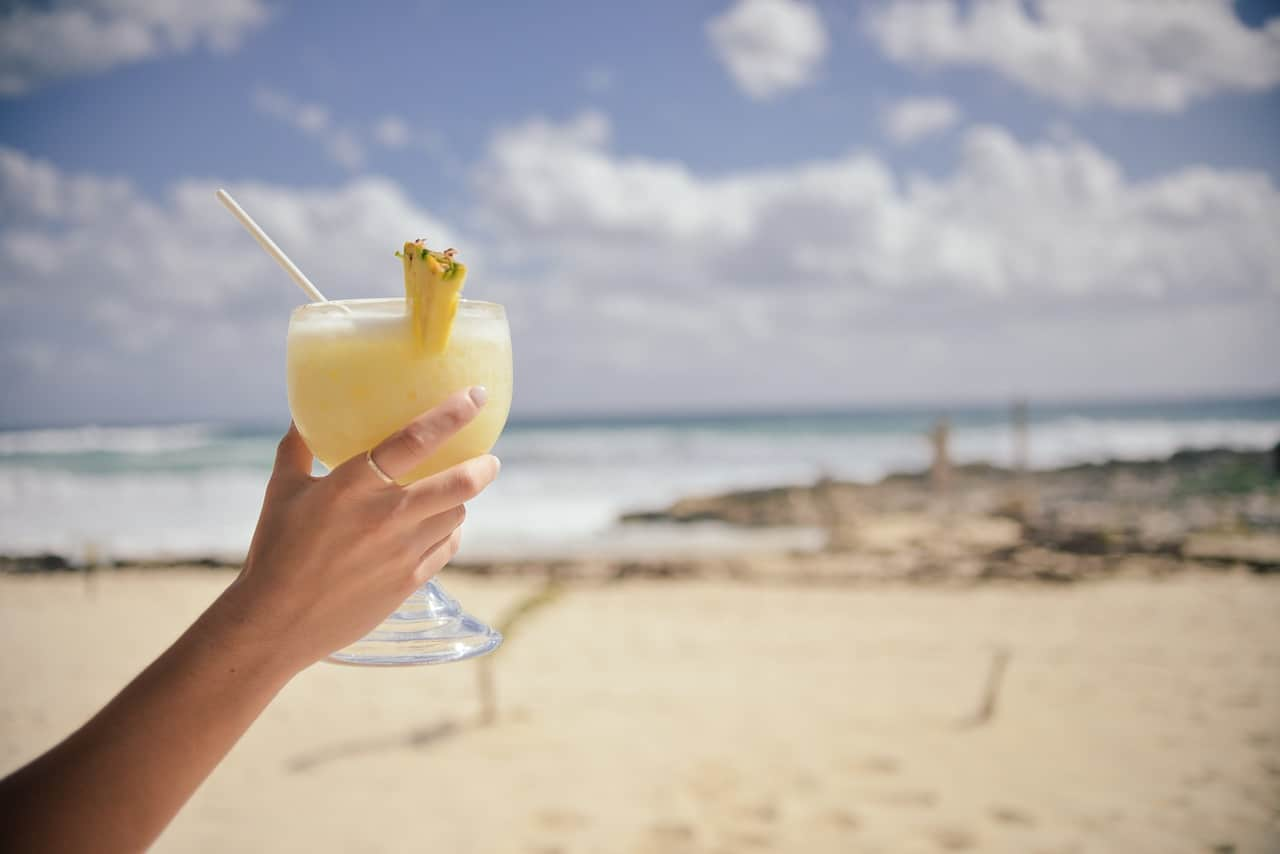 hand, beach, pina colada, puerto rico facts