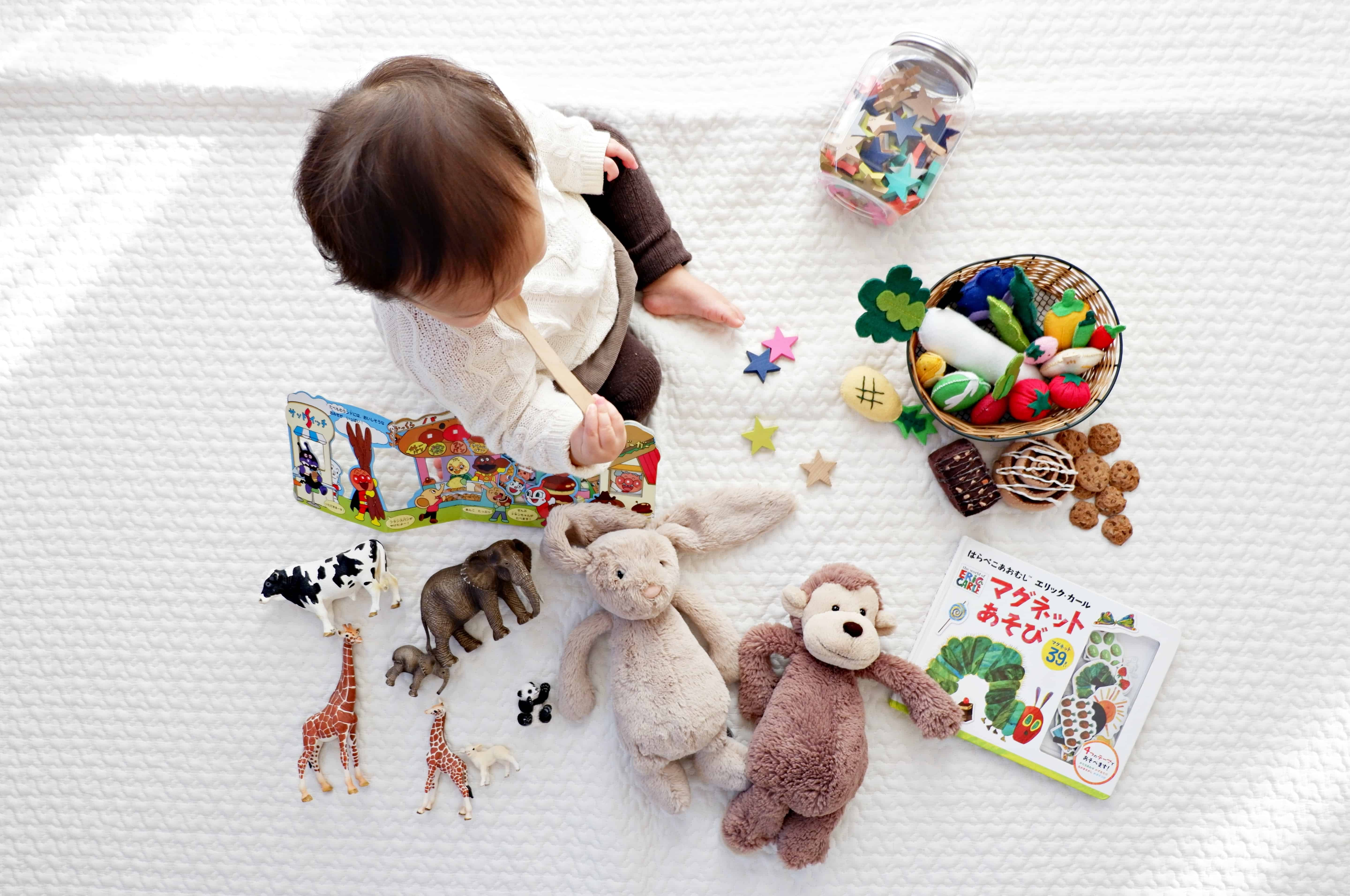 Baby with toys, baby facts