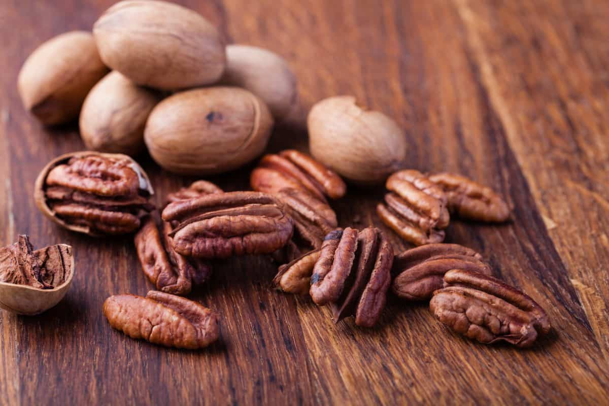 Pecan nuts on a wooden table, lifestyle facts