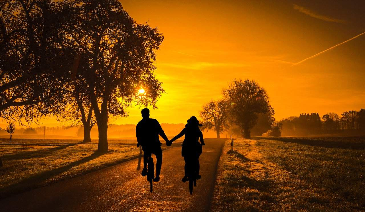 Facebook Facts, a couple riding in the sunset