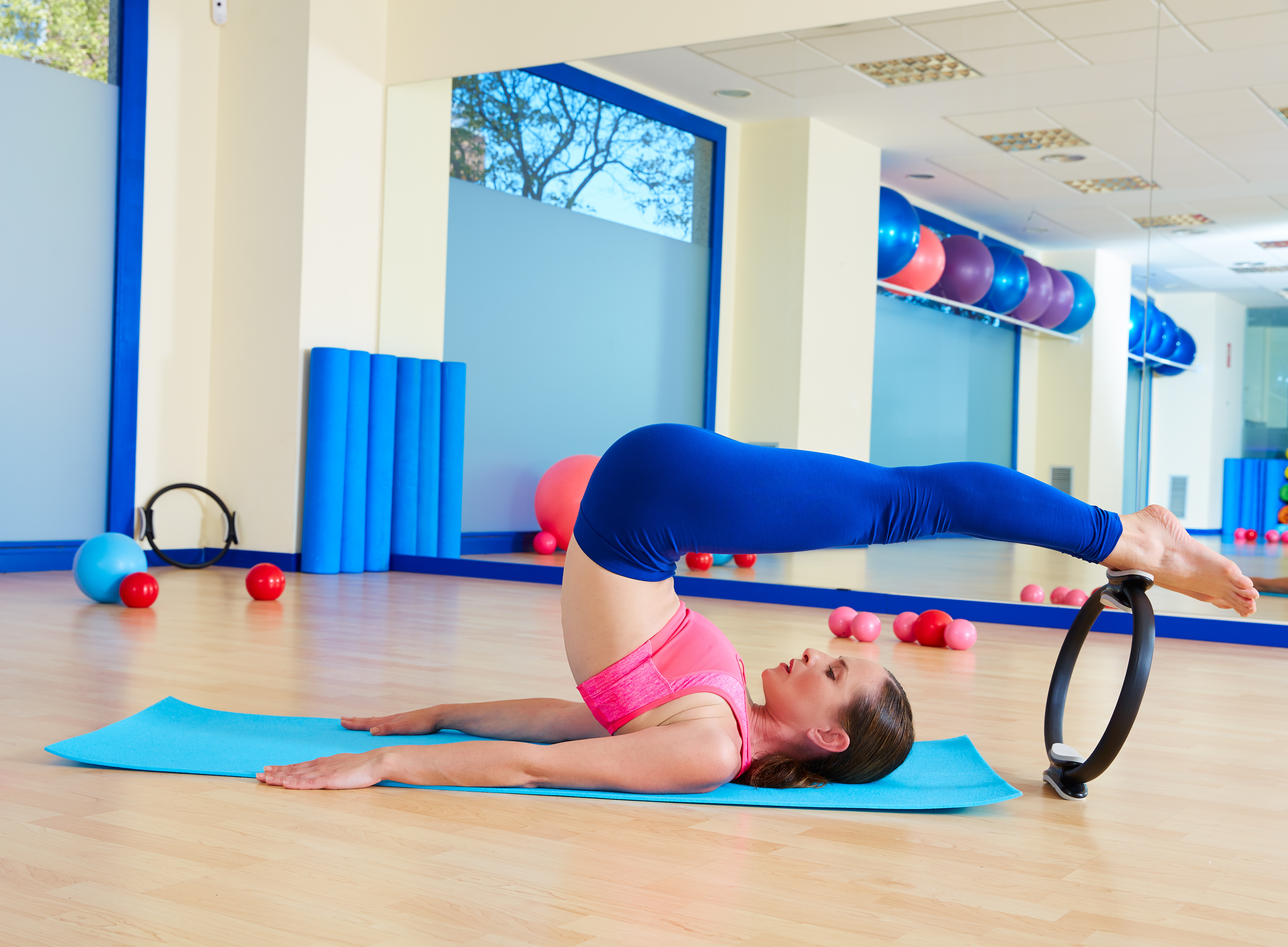 woman doing roll over pilates