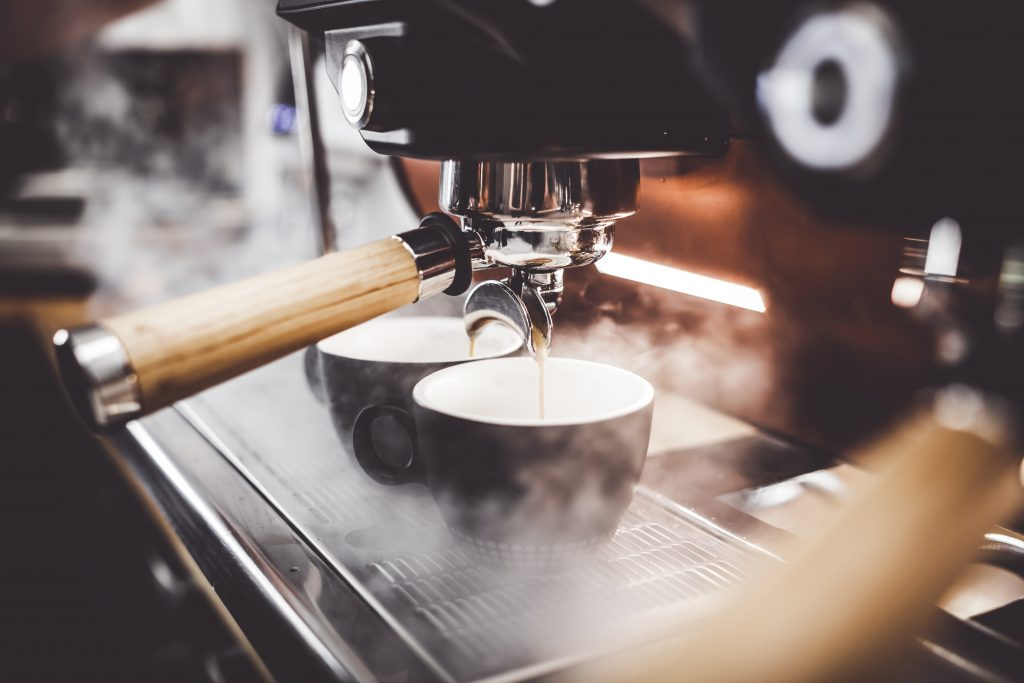 Coffee maker making coffee