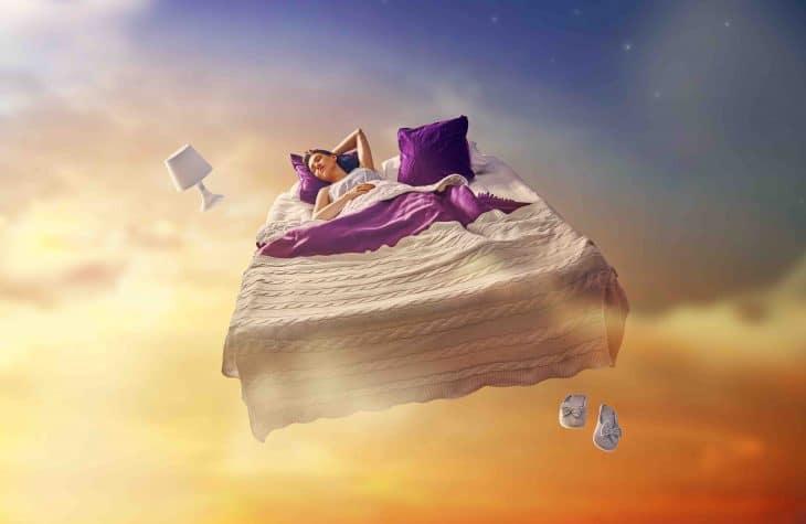 girl sleeping on floating bed, dreams