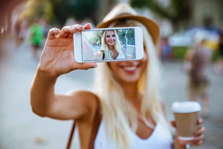 Girl taking selfie, selfie facts